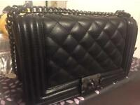 Chanel boy bag style in black handbag