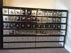 A set of 2 mirrored silver and black glass drawers
