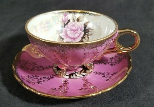 ROYAL SEALY IRIDESCENT TRI-FOOTED PINK & GOLD TEA CUP & SAUCER SET WITH ROSES