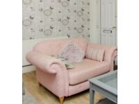 Pink small sofa/ cuddle chair and footstool