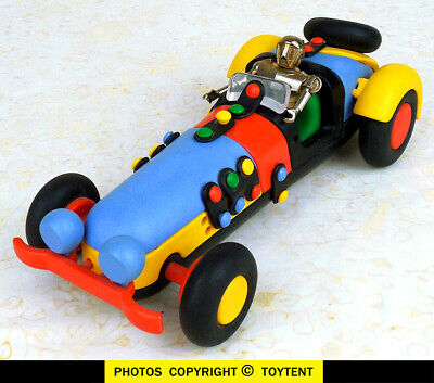 Big puzzle race car with Zylmex Micronauts metal man robot driver