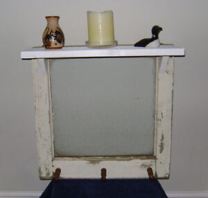 Vintage mirrored window with shelf