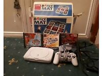 Playstation console PS1 and dance mat. 3 games included