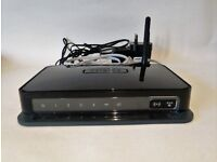 Netgear DGN1000 wireless-N 150 router with built-in DSL modem in good working condition