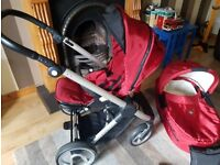 Mutsy Evo red pram and Carry cot
