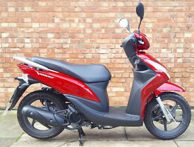 Honda Vision 110 with just 33 miles. Practically brand new!