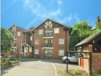 A spacious two bed flat with two bathrooms, parking and balcony close to Woodside Park station