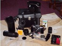 Practica Super TL metered prism camera and lenses