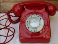 Vintage / Retro red rotary dial 746 telephone with red cord.