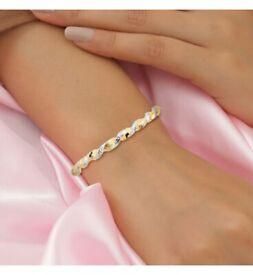 Dual Tone Diamond Cut Twisted Bangle in 9K Yellow Gold for sale