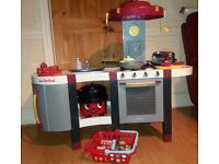 Deluxe Smoby Kitchen with accessories & vacuum cleaner.