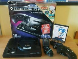 sega megadrive with nine games in perfect condition