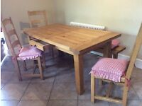 Oak kitchen table with three chairs and one long bench