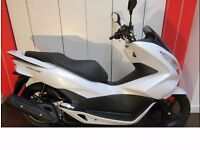 HONDA PCX 125 URGENT SALE. VERY GOOD CONDITION AND COME WITH HELMET AND ALL PROTECTION & PIZZA BOX