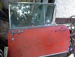 1956 olds 98 LF DOOR W/GLASS AND POWER WINDOW MOTOR GC $100.00