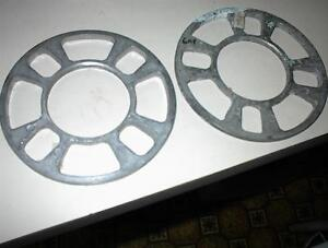 NEW PAIR OF 4 LUG WHEEL SPACERS $15.00