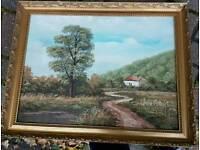 2 gold framed oil paintings.