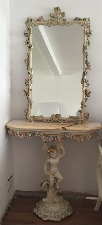 Art Deco style console table with marble top and mirror.