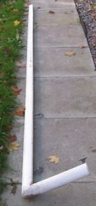 Long painted banister with some brackets still on it
