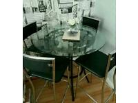 High Solid black base with Glass top with 4 leather and chrome chairs