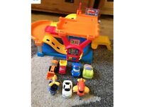 Toy Garage - multi coloured with car lift, sound effects and 5cars +2 airplanes