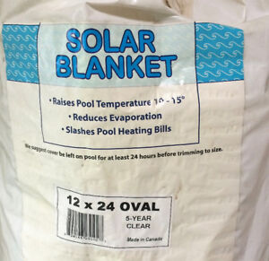 USED - BLUE WAVE 12' X 24' OVAL 12-MIL CLEAR SOLAR BLANKET - $50