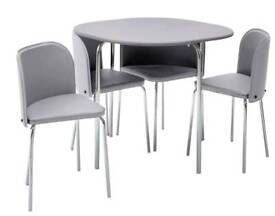 Brand new grey table with 4 grey chairs
