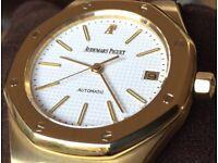 Men's Audemars Piguet Royal Oak Automatic in 18K gold. Boxes, manuals, winder and travel case.