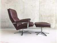 1970's Danish Mid century chestnut brown leather swivel armchair with matching footstool