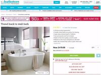 new bath, double ended. trend ,back to the wall , unused,needs panel,also, slipper bath