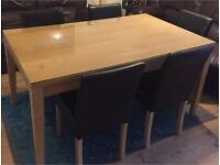 Dining table and 5 leather chairs for sale with glass top great condition delivery available