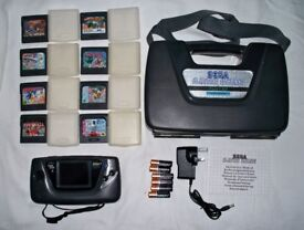 Sega game gear with hard case, batteries, bower supply, 8 games and instructions!!!!!