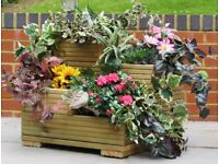 Brand new quality four tier flower planter. Unusual shape. Two sizes available.