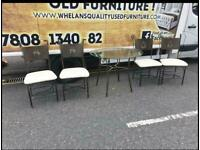 Glass & metal table and chairs £85 in very good condition