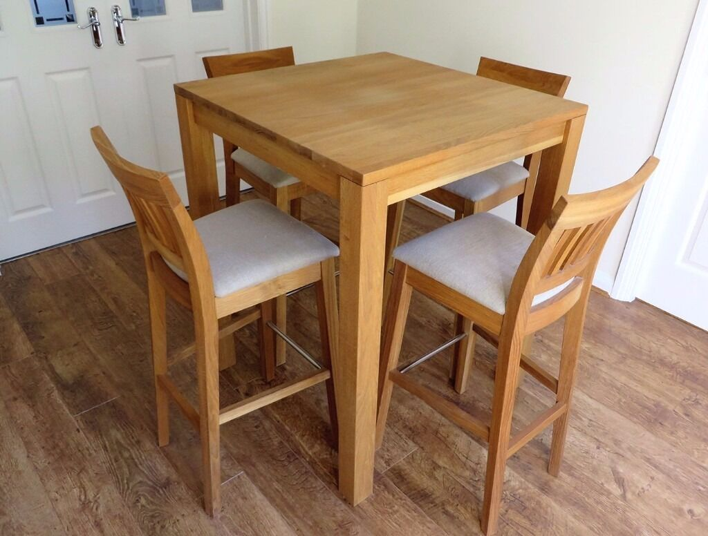 tall oak breakfast bar table and four java solid oak bar stool in beige fabric