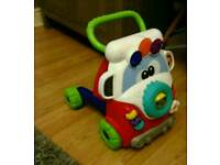 Baby walker with free musical push wheel