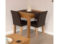Extendable solid oak dining table from Next