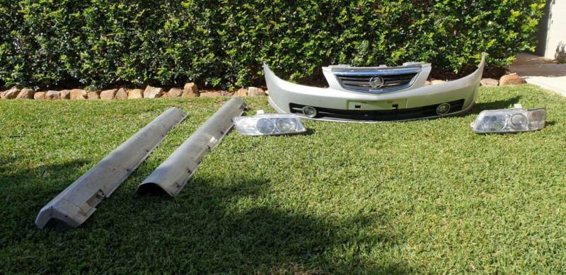 Vy commodore front bumper,side skirts and Head lights  | Auto