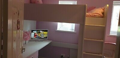 girls light pink/white bunk bed...Desk, 3 draws and wardrobe all connected.