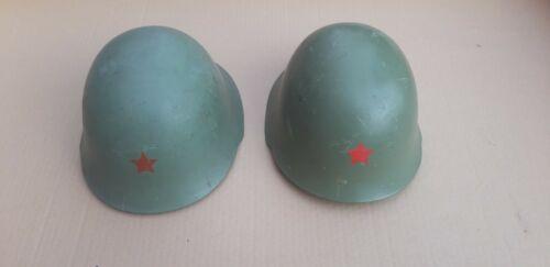Yugoslavia helmets pair