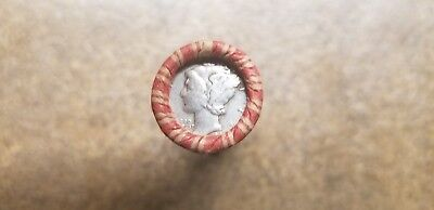 Roll of Raw unopened  Wheat Pennies with a silver Dime on the end