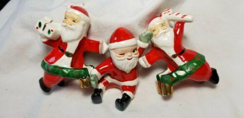 3 Vintage Christmas Santa candle hugger ceramic Japan bell present candy cane