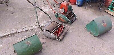 2 vintage lawn mowers