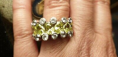 RARE VINTAGE PERIDOT STETLING SILVER 925 RING IN USED CONDITION.