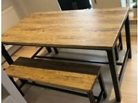 Faux wood dining table and benches