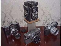 4 Vintage Cameras plus accessories.