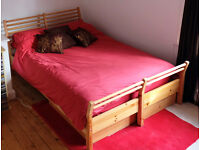 IKEA 'Sorum' Pine Double Bed, with 2 drawers underneath, good condition. Free mattress in protector