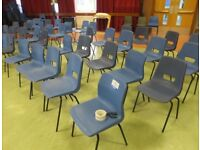 100 grey plastic stacking chairs in excellent condition. Come from high school closed down