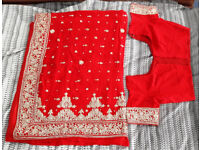 Indian bright red wedding saree, heavy silver embroidery, sequins with blouse
