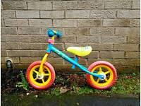 Little tykes glide along bike